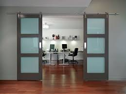 sliding office door. Modern Compact Home Office With Grey Midcentury Sliding Doors And Black  Leather Swivel Chair Also Stained Wooden Plank Floor Design Ideas: Sliding Office Door I
