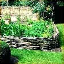 how to keep dogs out of flower beds garden from digging under fence ideas keeping an