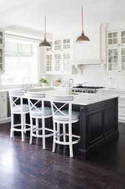 white cabinetry feature coloured island