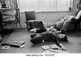 black kids watching tv. children watching tv television at home interior living room 1970s britain uk homer sykes - stock black kids tv