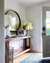 Modern farmhouse entryway with reclaimed wood console, round mirror and  white shiplap walls. (Styling with mirror, wood decor, and hydrangeas)