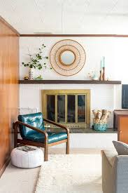 mid century modern living room with white brick fireplace