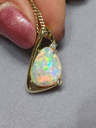 crystal opal 5 colour gem set in 18ct gold with diamonds code 20203535 a 6000