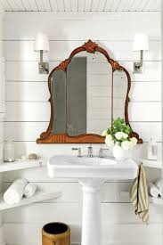 farmhouse pedestal sink. Small White Farmhouse Bath With Mirror Salvaged From An Old Vanity Table Built In Corner Shelves Pedestal Sink Perfect On