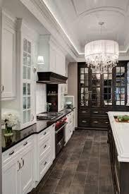 white kitchen dark tile floors. Lincolnwood Design Showroom Kitchen Display · Black CountersBlack Counter White Dark Tile Floors T