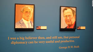 a self portrait of former president george w bush left and a