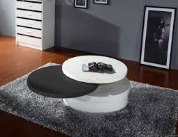 furniture round tempered white and black lacquer coffee table plus black fur rug on laminate