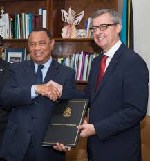 royal caribbean s pact includes training for hospitality jobs prime minister perry christie left and royal caribbean ceo michael bayley shake on
