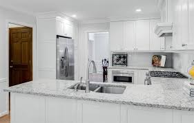 kitchen with white alpha granite countertops with white cabinets