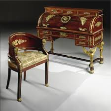 AN EMPIRE STYLE GILT-BRONZE MOUNTED FLAMED MAHOGANY ROLL TOP DESK AND  CHAIR<br