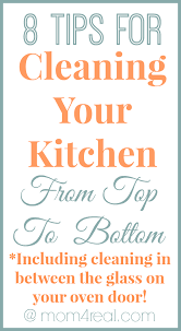 tips for cleaning your kitchen from top to bottom including cleaning in between the glass