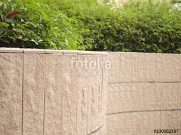 exterior decoration of garden on a gravel concrete wall