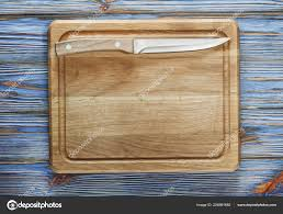 chopping board knife on vintage wooden background
