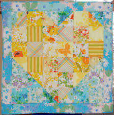 <b>Sweet Vintage Heart</b> Baby Quilt | FaveQuilts.com