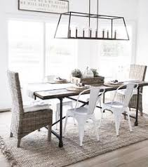 cal farmhouse dining room with linear chandelier