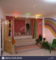 Pink And Green Walls In A Bedroom Steps Up To Bed In Teenagers Nineties Bedroom With Pink And Green