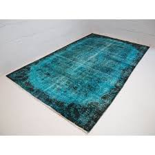 black and teal over dyed vintage rug
