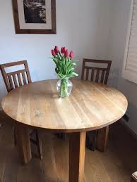 4 foot wide round oak table and 4 chairs