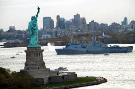 u s department of defense photo essay the amphibious dock landing ship precommissioning unit new york transits new york harbor past the statue