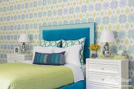 blue velvet headboard with green bedding