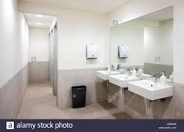 public bathroom mirror. Plain Bathroom Empty Public Bathroom With White Sinks And Wide Wall Mirror Air Hand Drier  Black Recycle Bin Intended Public Bathroom Mirror O