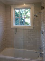 recessed lighting over shower. love the gray subway tiles recessed lighting and glass shower door over o