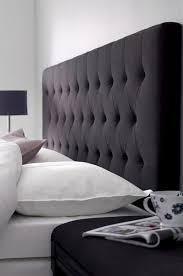 headboard but in a pale color with dark brown walls.