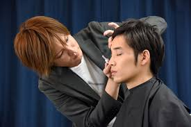 hiroki takahashi applies makeup on tomoya kubo at his office in tokyo last week