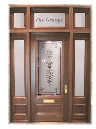the grange door manufacturer with teak materials and fiberglass sporting particular glass painting and block sculpture