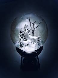 Mysterious glowing snow globe of white ...