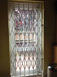 Decorative Security Grilles For Windows Rsg1000 Retractable Security Grills Fitted Internally To The Door