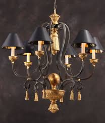 carved wood and wrought iron chandelier with round black hardback shades