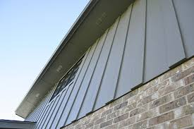 vertical siding using harpanel timberbark fiber cement siding with alside aluminum gutters in orland park