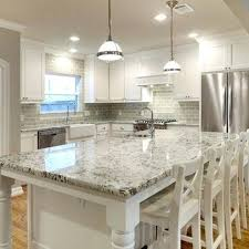 white cabinets with gray granite white granite and glass subway tile dark wood floors would make white cabinets with gray granite