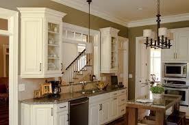 traditional kitchen with glazed linen raised panel door cabinets and oil brushed bronzed cabinet pulls and