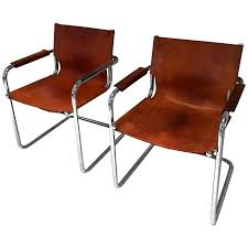 pair of mart stam style cantilevered leather and chrome chairs for