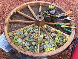 wagon wheel garden such a neat idea for planting flowers