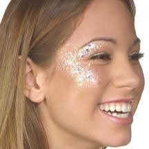 glastonbury festival fashion inspiration hippie bohemian boho glitter makeup metallic face paint beauty holographic eyes