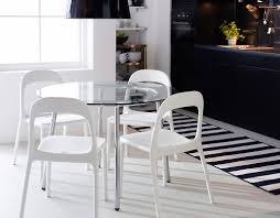 glass round dining table and 4 chairs. glass round dining table with 4 chairs and i