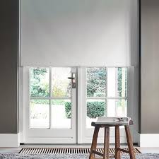 co living cut to width bright white fabric blackout motorized roller shade 29