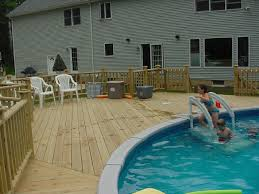 Above ground pool with deck attached to house 27 Ft Above Ground Pool Deck Custom Decks Plus Deck Photos3