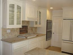 kitchen clear glass kitchen cabinet door decor with white small kitchen cabinet and cream frosted stone kitchen countertop plus white painted wood door