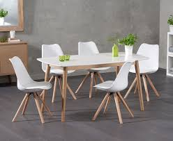 newark 150cm oak and white dining table with ophelia round leg faux leather chairs