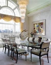 dining room modern tiered chandelier glass table modern sculpture on table