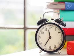 Retro Alarm Clock On Text Books Near The Window Sunny Day In