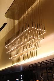 four tier polished brass chandelier reel cinema dubai light source led