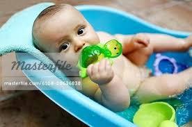 baby boy bath 8 months baby boy taking a bath stock photo baby boy bathrobe newborn baby boy bath