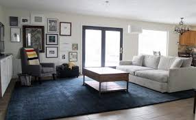 black charcoal big area rugs for living room ideas to enhanced the room decor get along with the grey stuffed sofa and wingback chair also solid wood small