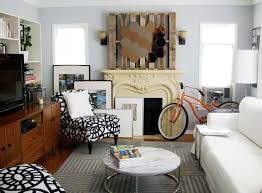 ikea mirrors on a pallet above the fireplace
