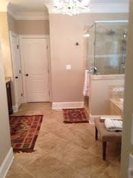 not sure where to place rugs size for vanity shower and tub bought these today not sure should i have a large rug in the center of the room